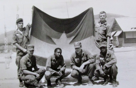 John Sanderson of Heron Creek subdivision in North Port  (holding flag right) and his four-man Recon-Team learn the ropes at a school established in Nha Trang, Vietnam to train American soldiers to secretly scout out the enemy during the Vietnam War. His team captured the enemy flag not during a training exercise. Photo provided