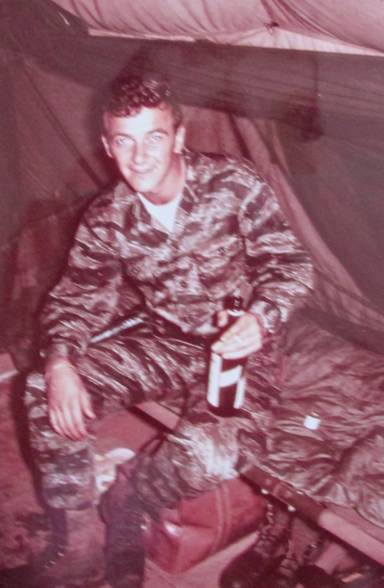 Sgt. Sanderson at 20 with a bottle of Scotch shortly after returning from a five-day patrol with this team looking for North Vietnam Army or Vietcong activity in the bush. Photo provided