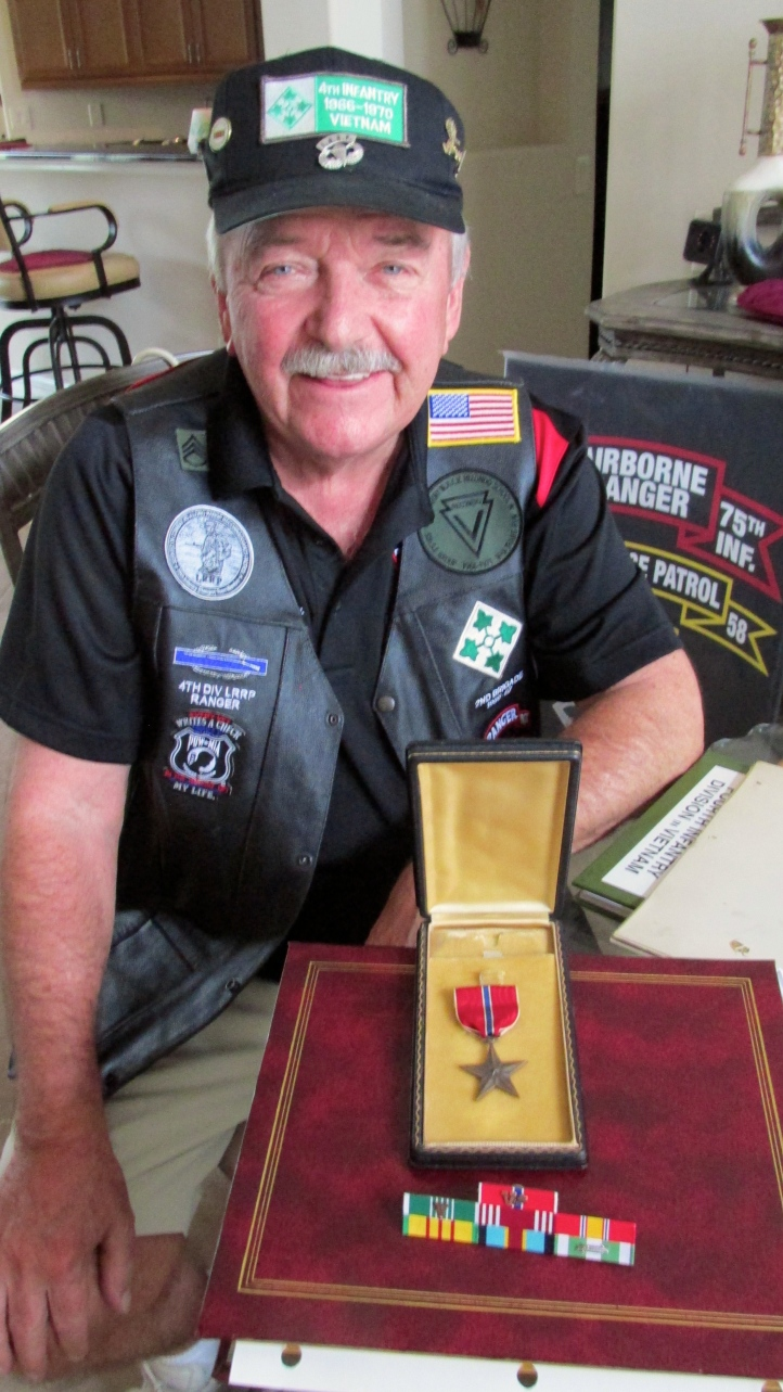 Sanderson with his commendations. He received two Bronze Stars with V for Valor, an Army Commendation Medal and a Combat Infantryman's Badge fighting with the 4th Infantry Division as a long range reconnaissance scout in Vietnam. Sun photo by Don Moore