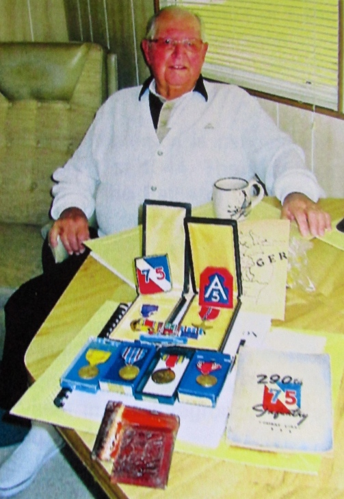 Otis Nickerson of Holiday Park in North Port is pictured with his World War II medals. Among his commendations are the Purple Heart and the Bronze Star for valor. However, the split wallet in the foreground is his favorite war memento. It saved his life. Sun photo by Don Moore