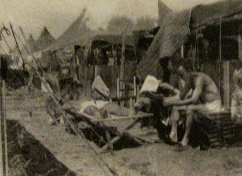 The fellow in the army cot is Maj. Bill Richardson taking it easy reading a paper at Camp lucky Strike on his way home from Europe after tWorld War II. Photo provided