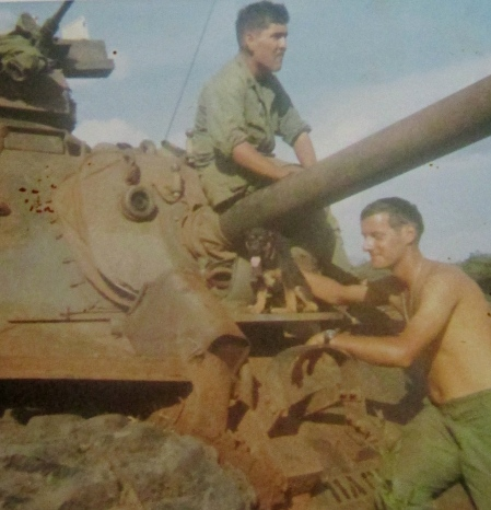 "Spc. 4 Herman Stapleton of Punta Gorda is on top checking out his M-4 ""Patton"" tank in Vietnam. He was a tank driver who served with the 11th Cavalry there in 1968-69. Photo provided."