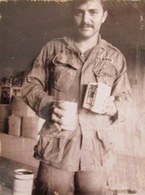 Having a cold one, Stapleton has a beer back at base somewhere in Vietnam during the War. Photo provided