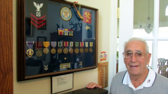 "Nicholas has a shadowbox of World War II commendations. He took part in the invasion of North Africa, the Normandy Invasion and in-between these two historic events he was a member of the Scouts and Rangers who helped build the Amphibious Warfare School at Fort Pierce and train ""Frogmen,"" forerunners of today's Seals. Sun photo by Don Moore"