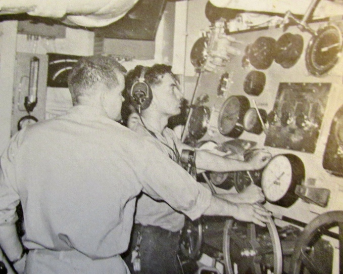 Machinist-mate Harris at the main throttle of the destroyer USS Mason. Photo provided
