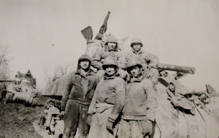 "This is Sgt. ""Beaver"" Radebaugh's Sherman tank crew that was part of Gen. Omar Bradley's 1st Army in Europe during the Second World War. He's the little guy at the top left. Photo provided."