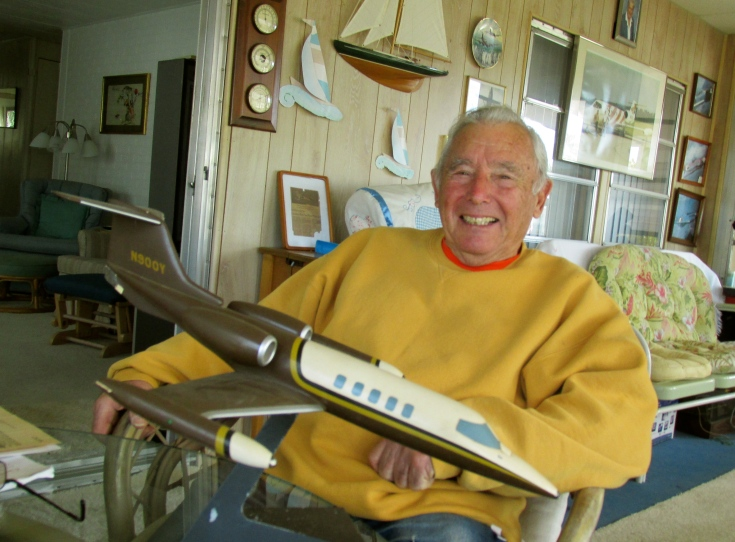 """Beaver"" Radenbaugh holds a model of a Lear Jet like the one he spent years flying around the country and the world that was part of an air taxi company he worked for for a quarter century. Sun photo by Don Moore"