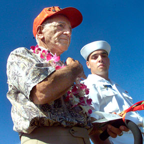 CTY WEST LOCH -Ship's cook second class Roy Sannella crossed his chest just prior to throwing in two long stemmed roses during the 60th Commemoration Ceremony of the West Loch Disaster held in Pearl Harbor yesterday. Honolulou Star-Bulletin Photo by Cindy Ellen Russell, 05-21-04