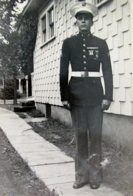 Cpl. Carl Cowin U.S. Marine Corps is pictured beside his parents' Eau Claire, Wis. home during World War II. Photo provided