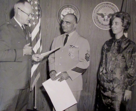 Chief Quartermaster Tom Martorana receives the Joint Service Commendation Medal from Gen. Ralph Stakley for his two years of service working as a member of the Joint Reconnasisance Center run by the Joint Chiefs of Staff in Washington, D.C. at his retirement in October 1967 after 23 1/2 years of service. His wife Dolores looks on. Photo provided