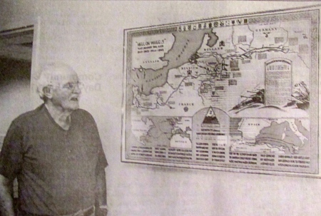 Bill Kilfeder takes a look at a map on the wall of his daughter's office at the Douglas T. Jacobson State Veterans Nursing Home in Port Charlotte, Fla. The map shows the route the 2nd Armored Division, his outfit, from the time it left the United States, Africa, fought in the Sicilian Campaign, made the Normandy Invasion and continued fighting through Europe.  Sun photo by Don Moore