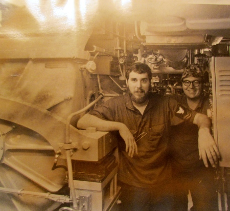 Electrician's Mate Jim Winslow (left) stands with a buddy near the electrical generator abroad the nuclear missile submarine USS Francis Scott Key in the 1970s. Photo provided
