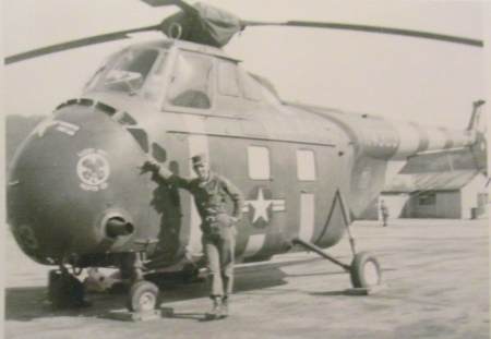 19-year-old crew chief Francis Durso leans against his H-19 Sikorsky helicopter in Korea in 1955. He spent 18 months there. Photo provided