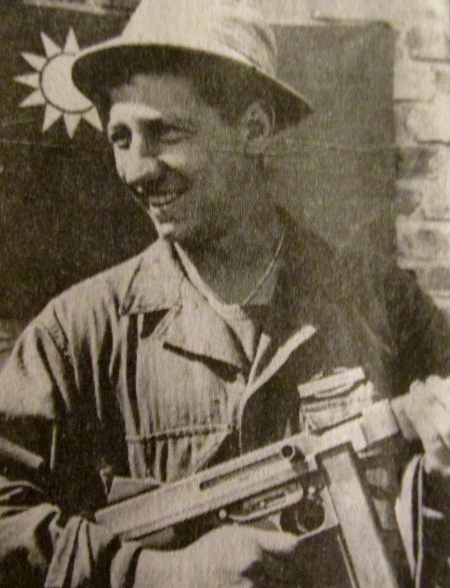 Nick Casertano of Venice, Fla. is pictured with a Thompson submachine gun while serving in China during World War II. Photo provided
