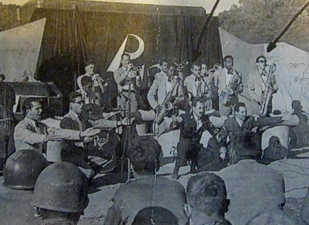 Henry Fallon (left arrow) and Budd Brown (right arrow) are pictured with the rest of the 8th Army Band in Korea during the 1950s. Photo provided