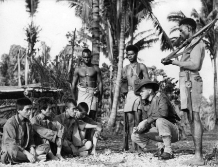 New Guinea natives like the ones pictured here cornered Francis Drab on a local beach . Here they're involved in the interrogation of Japanese prisoners during World War II. Photo provided