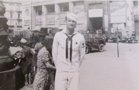 Radioman Lowell Biderman of Oyster Creek, Englewood served aboard the USS Pine Island at the end of WW II. Here he is standing in front of the Red Cross building in Naples, Italy during his voyage to show the flag around the world after the war. He was 19 when this picture was taken. Photo provided
