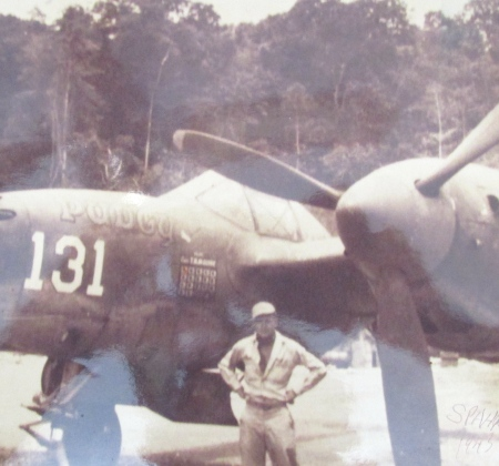 "Sgt. Von Spahr of Englewood stands in front of ""Pudgy V,"" McGuire's P-38 that he flew to shoot down 38 Japanese planes during the Second World War. He was posthumously awarded the Medal of Honor for his flying achievements. Photo provided"