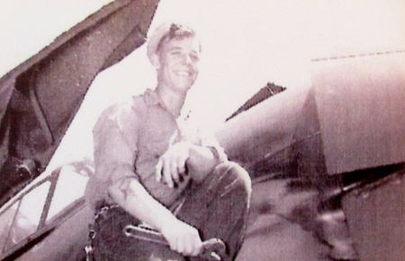 Mack Mileski is pictured here working on the wing of a torpedo bomber he kept flying during the war while serving on the USS Santee. Photo provided