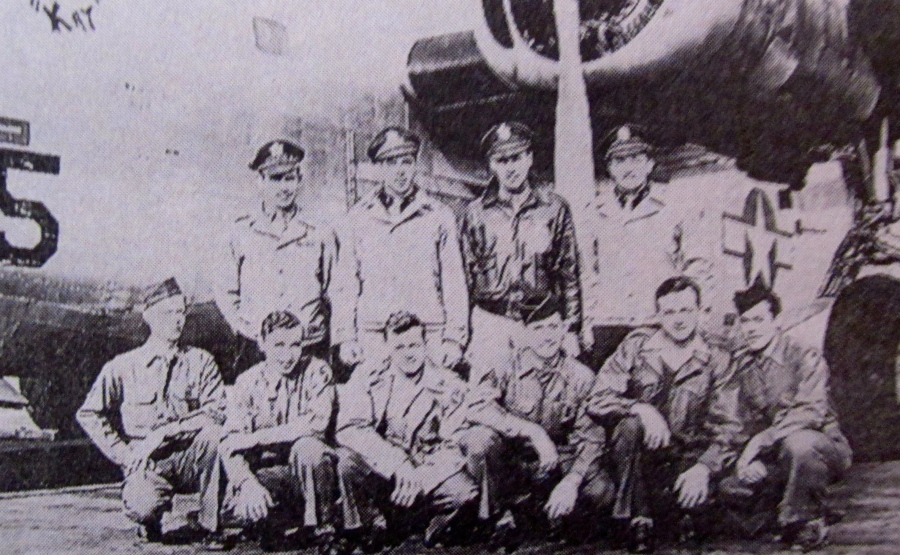 """Second Lt. Jim Paton is standing 2nd from the left in the front of a B-24 Liberator. He was a member of the """"Carpetbaggers,"""" a secret unit that dropped saboteurs behind enemy lines in Europe at night. Photo provided by Jim Paton"""