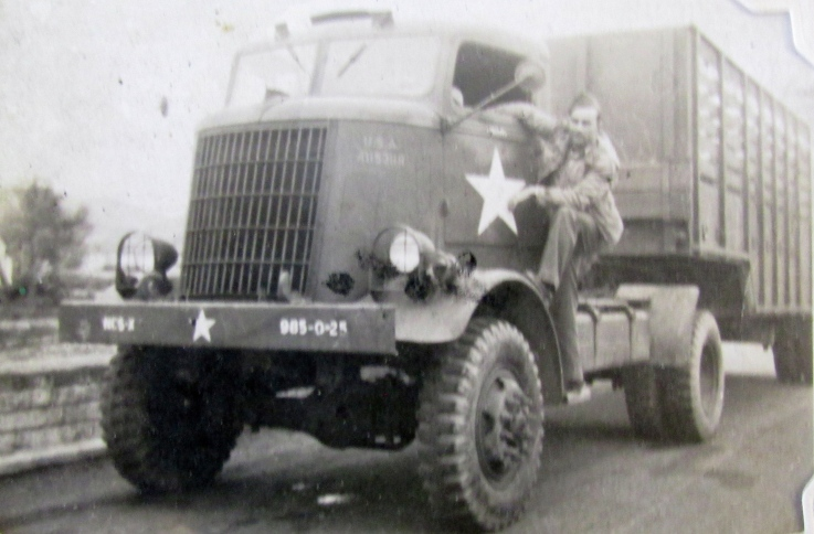 Hampton squats on the running board of his Federal-made semi-truck that had a top speed of 41 mph and went 3 miles on a gallon of gas. He drove it all over Europe with the 1st and 3rd Armies during World War II. Photo provided