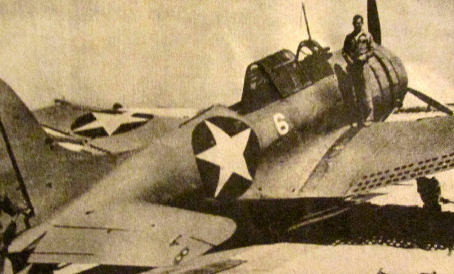 Marine Lt. Daniel Iverson stands on the wing of his SBD-2 Dauntless dive bomber following the Battle of Midway in World War II. He brought his battered plane back with more than 200 bullet and cannon holes in it after attacking the Japanese carrier Hiru on June 4, 1942. Photo provided