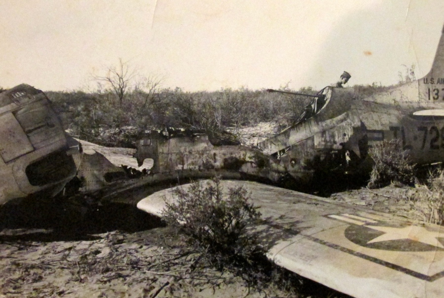 "Lt. Johnson and an instructor pilot were flying in this T-28 ""Trojan"" plane when the motor quit and they had to set it down in a field. Both survived the incident. Photo provided"