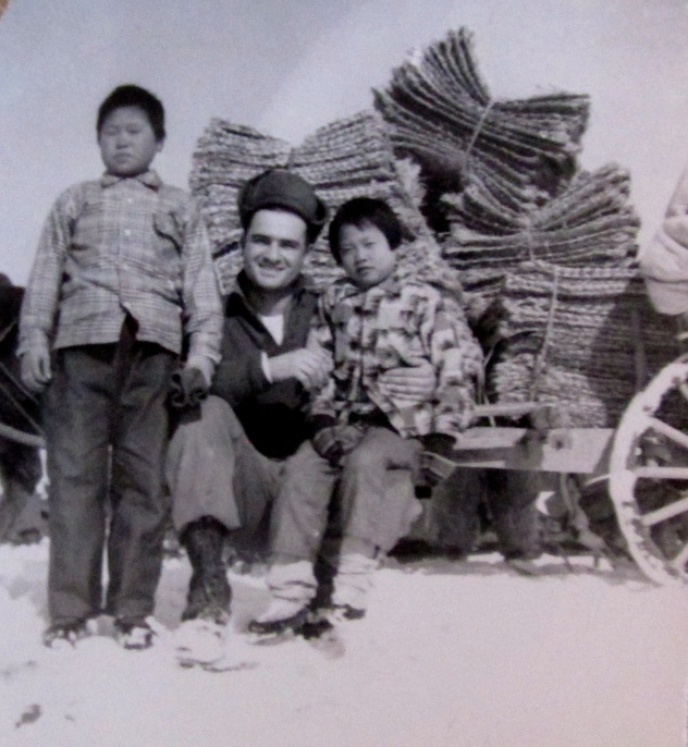 Frank poses with a couple of South Korean orphans he helped when his unit wasn't firing its Howitzer at the enemy. Photo provided