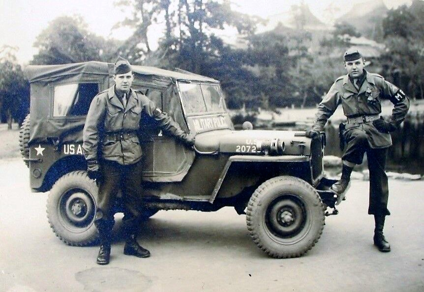 Sgt. Richard Mikutis (right) and a fellow MP are pictured with their Jeep just before going out to patrol the streets of Kyoto, Japan in 1945 as part of the occupation forces immediately after World War II. Photo provided