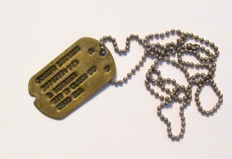 Joe still has one of his dog-tags from his Army service 75 years ago. Sun photo by Don Moore