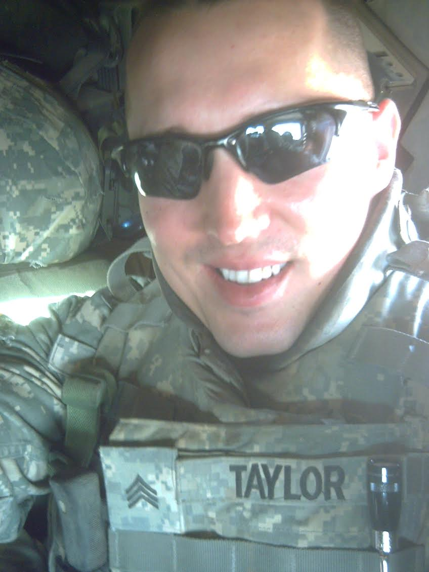 Sgt. Daren Taylor of North Port is pictured on a flight from Iraq back to Kuwait. He served with the 1st Cavalry Division as a combat medic there in 2006 and 07. Photo provided