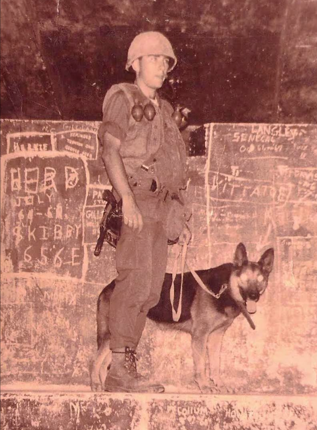 Airman John Langley of Venice, Fla. and his guard-dog 'Vogie' took on NVA & VC during Vietnam War