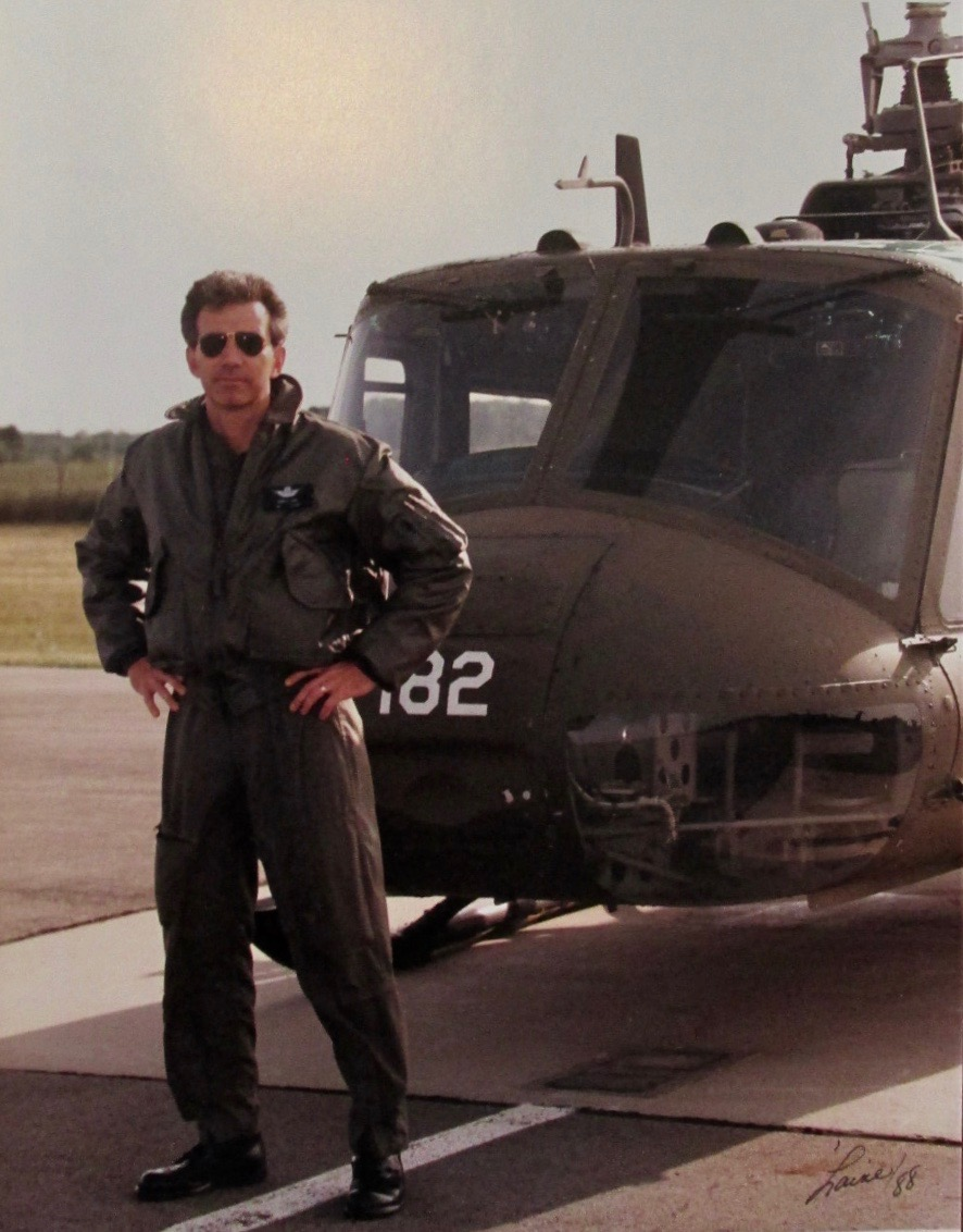 Laney is standing in front of his Huey helicopter he flew in Grand Ledge, Michigan with the Army National Guard. He was roughly 35 at the time. Photo provided