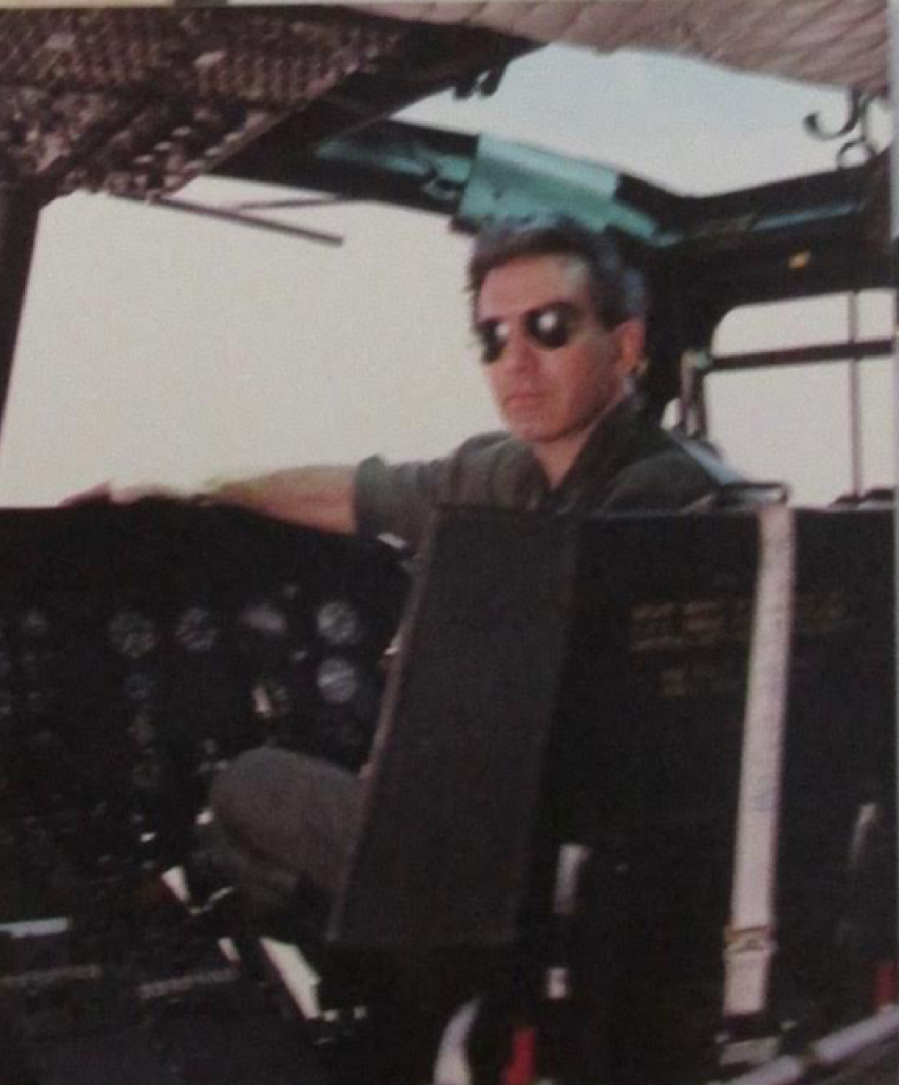 Randy Laney of Englewood sits in the pilot seat of a Huey helicopter he used to teach young Army lieutenants how to fly. He has 9,000 hours flying time in helicopters over the past 45 years. Photo provided