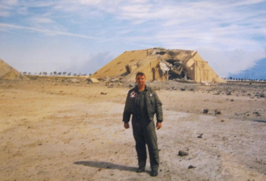 Simpson stands in front of a bombed out hanger in Kuwait that at one time housed Iranian MIG fighters. The hanger was at the Al Jaben Air Base in Kuwait. Photo provided