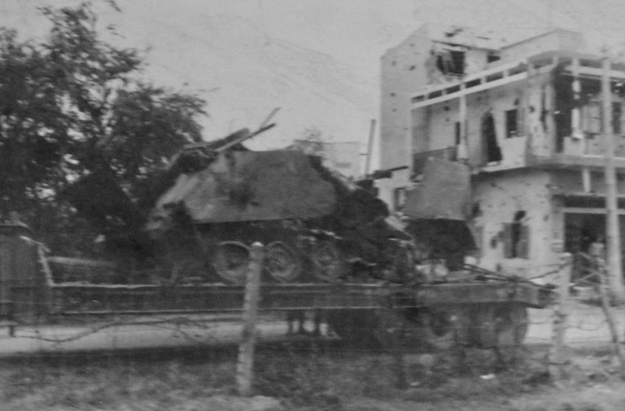 A wrecked APC sits on a trailer after the Battle of Chalon, a suburb of Saigon, that Uhlich participated in. It was probably hit by an enemy rocket propelled grenade. In the background you can see part of the bombed out community. Photo provided