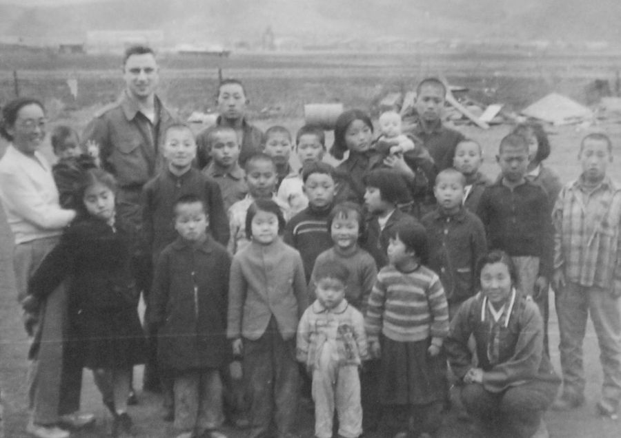 1st Lt Paul Winemiller is shown with the founder of the orphanage on the far left and a few of the children he looked after in Korea. Photo provided