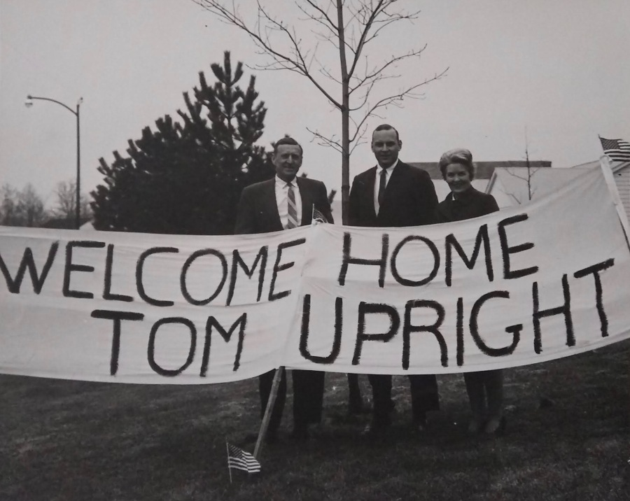 This banner was hanging from the front of the Upright's home when Tom returned from Vietnam in April '69. His father, Richard, is at the left, Tom center, and Helen, his mother at the right. Photo provided