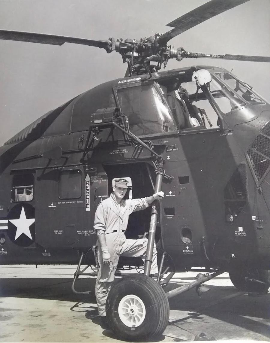 Upright is shown with a Sikorsky HU-34 Medivac helicopter like the one he flew in Vietnam during the war.  Photo Provided