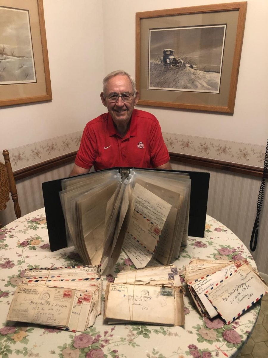 Murph is surrounded by all  the letters he sent to his mother during Korea. She  kept them for years and he ended up with them all over again. Photo provided by Erin Murphy.
