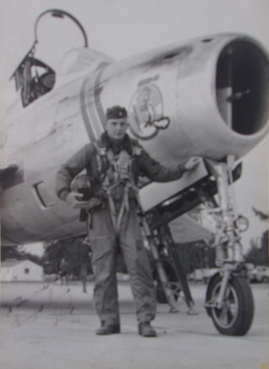 "Akers stands in front of the F-86 ""Sabre"