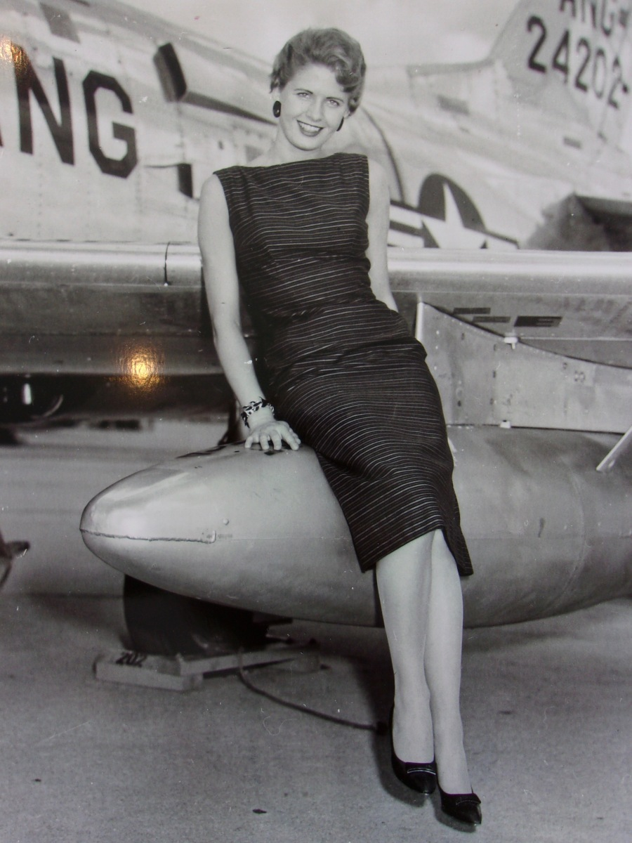 Marilyn Akers perches on the wing of Bob's F-86 when he was still in the Air Force Reserves. Photo Provided