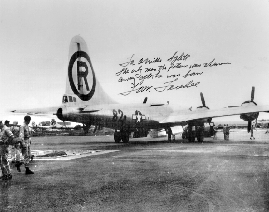 "The 'Enola Gay"" sits on the runway on Tinian Island just before its flight to Hiroshima. Note Paul Tibbets, the pilot's; Tom Ferbee, the bombardier's; and Duke Van Kirk, the navigator's signatures at the bottom of the picture. Tibbets and his crew were part of the 509th Composite Group, a special unit that trained for a single bombing mission."
