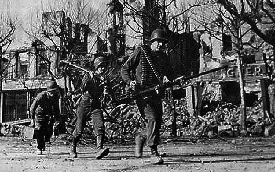 These soldiers in Gen. George Patton's 3rd Army advance through Saartautem, Germany on 15 Feb. 1945 during the last 90 days of the war in Europe. By this time Lt. Harry Long of Punta Gorda, Fla., a 3rd Army medical officer, was being held as a POW by the Germans.