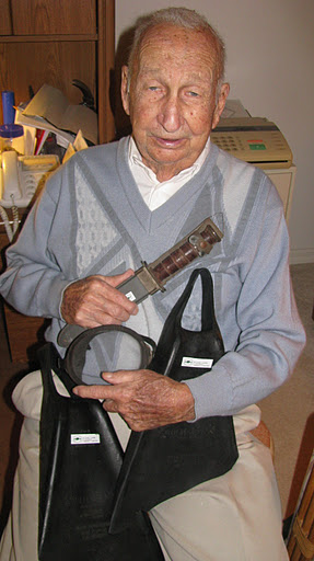 "Lumsden holds the flippers, mask and knife he used during the invasions of Iwo Jima, Okinawa and Borneo when he served as a ""Frogman"" in World War II."