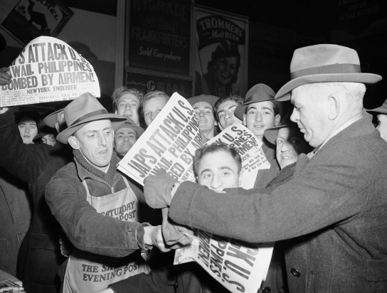 People grab newspapers hot off the press in New York's Times Square announcing that the Japanese bombed Pearl Harbor on Dec. 7, 1941. AP photo